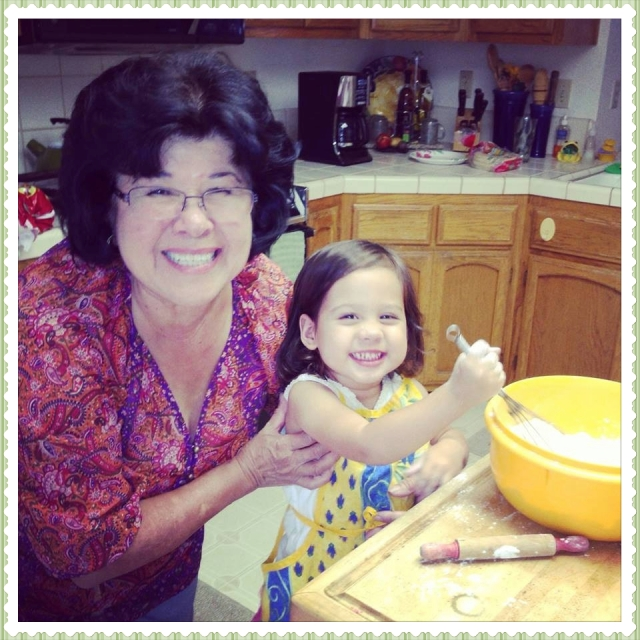 Oliva age 2 and her abuelita, mi mama making tortillas.